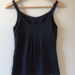 Black athletic tank with ruched detail on back.